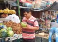 People drinking coconut water to get relief from heat
