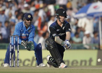New Zealand's James Neesham plays a shot during their third one-day international cricket match against India in Mohali, India, Sunday, Oct. 23, 2016. (AP Photo/Tsering Topgyal)